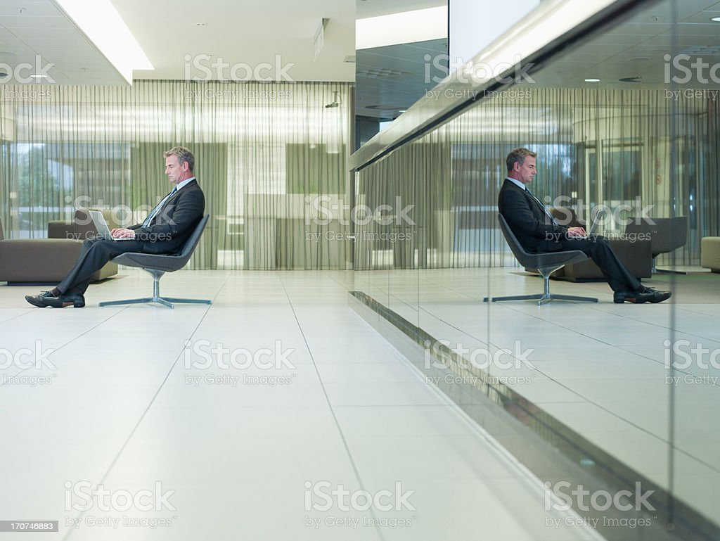 Businessman typing on laptop in office royalty-free stock photo