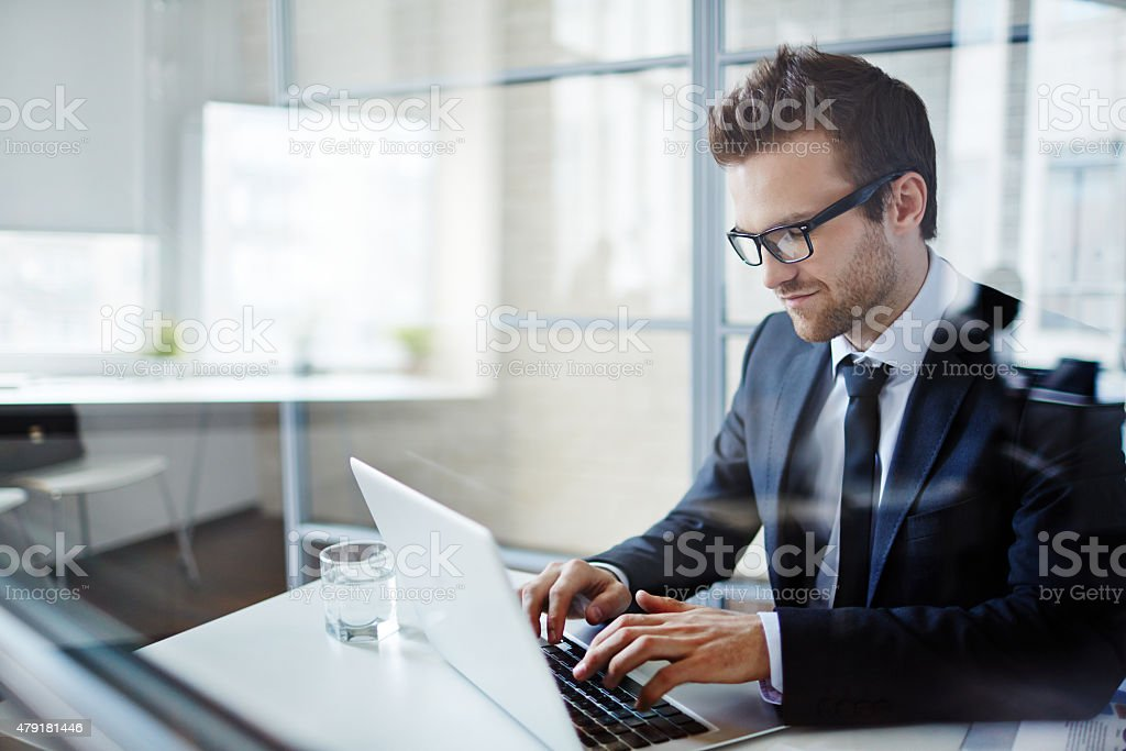 Businessman typing stock photo