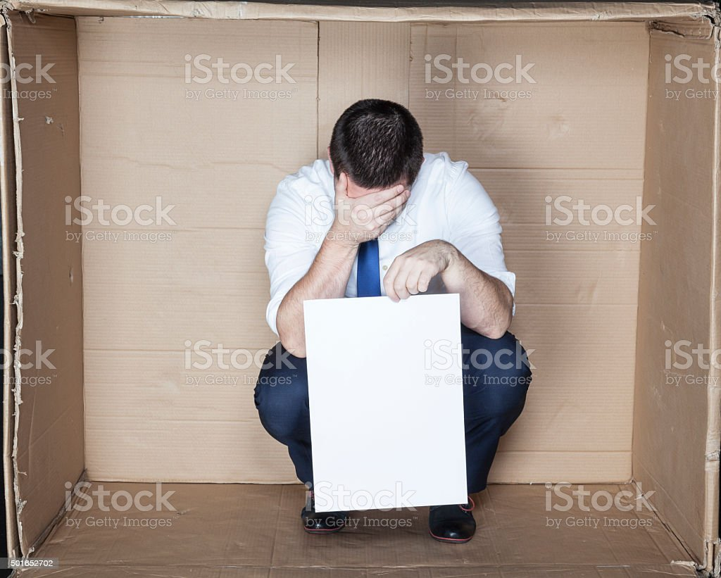 businessman unable to find work stock photo