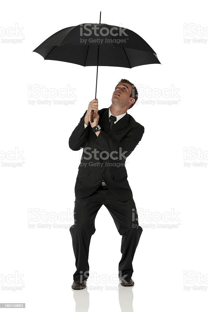 Businessman under an umbrella royalty-free stock photo