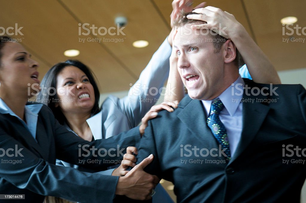 Businessman under attack royalty-free stock photo