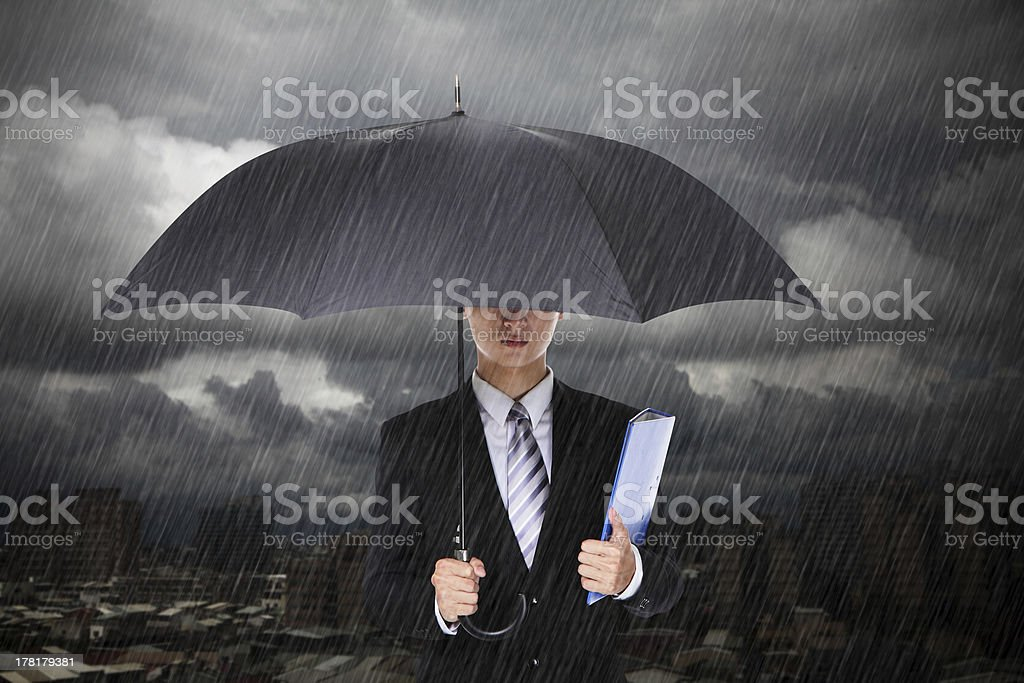 Businessman under heavy rain royalty-free stock photo