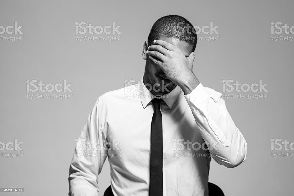 Businessman under stress stock photo