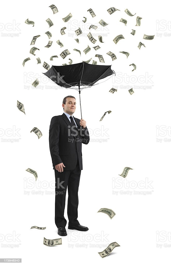 Businessman Under The Money Rain stock photo