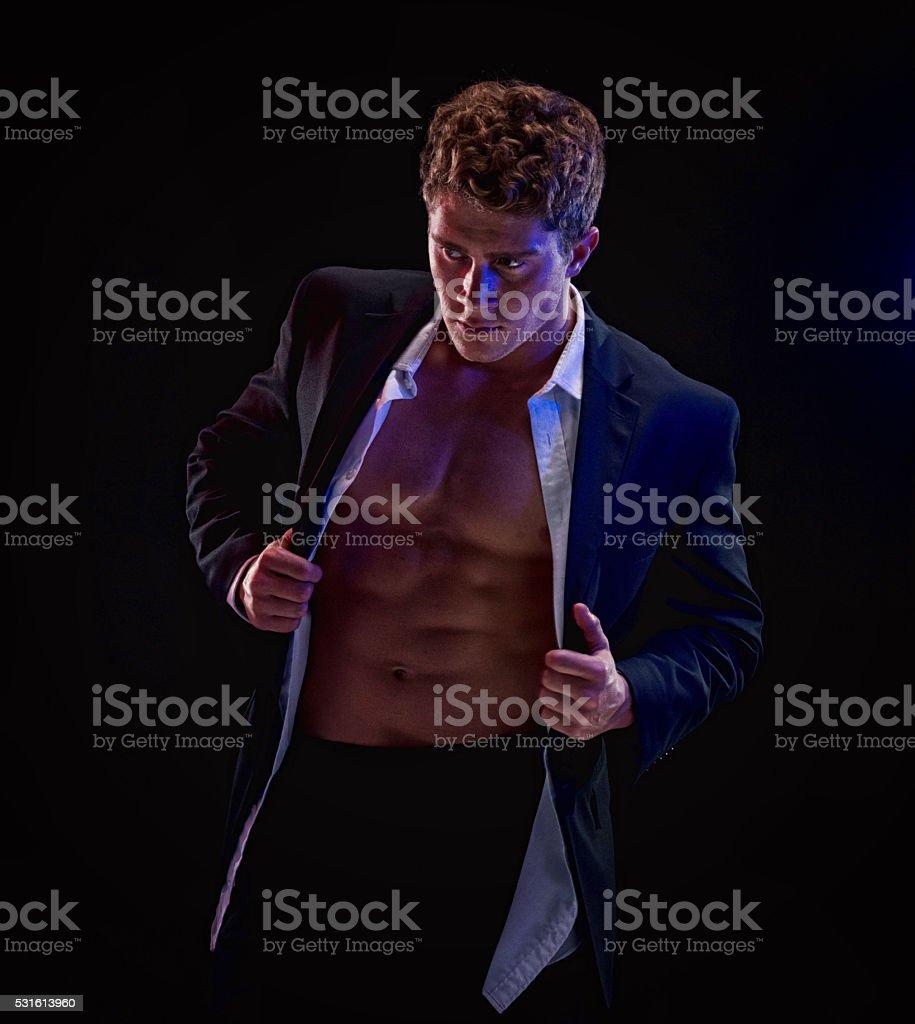 Businessman undressing stock photo