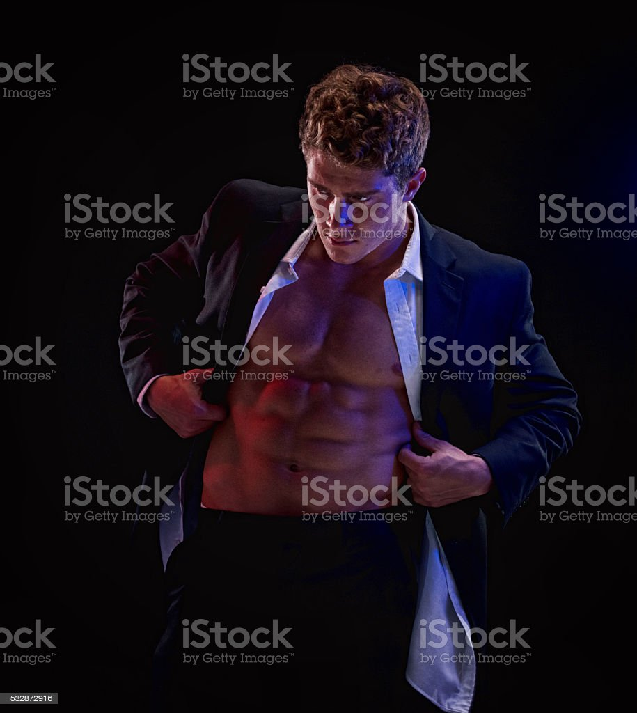 Businessman undressing stock photo