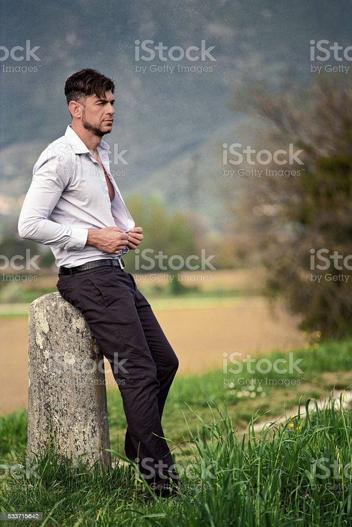 Businessman unwinds and relaxes in the countryside stock photo