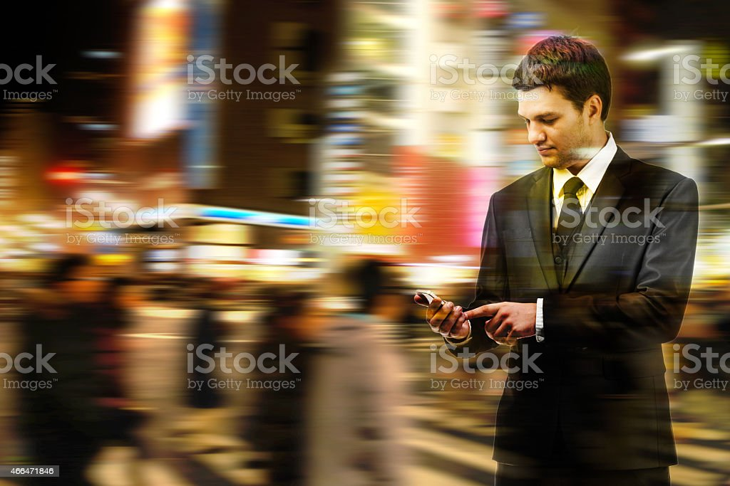businessman uses a smartphone on the street stock photo