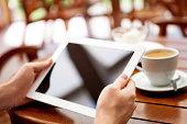 Businessman uses digital tablet