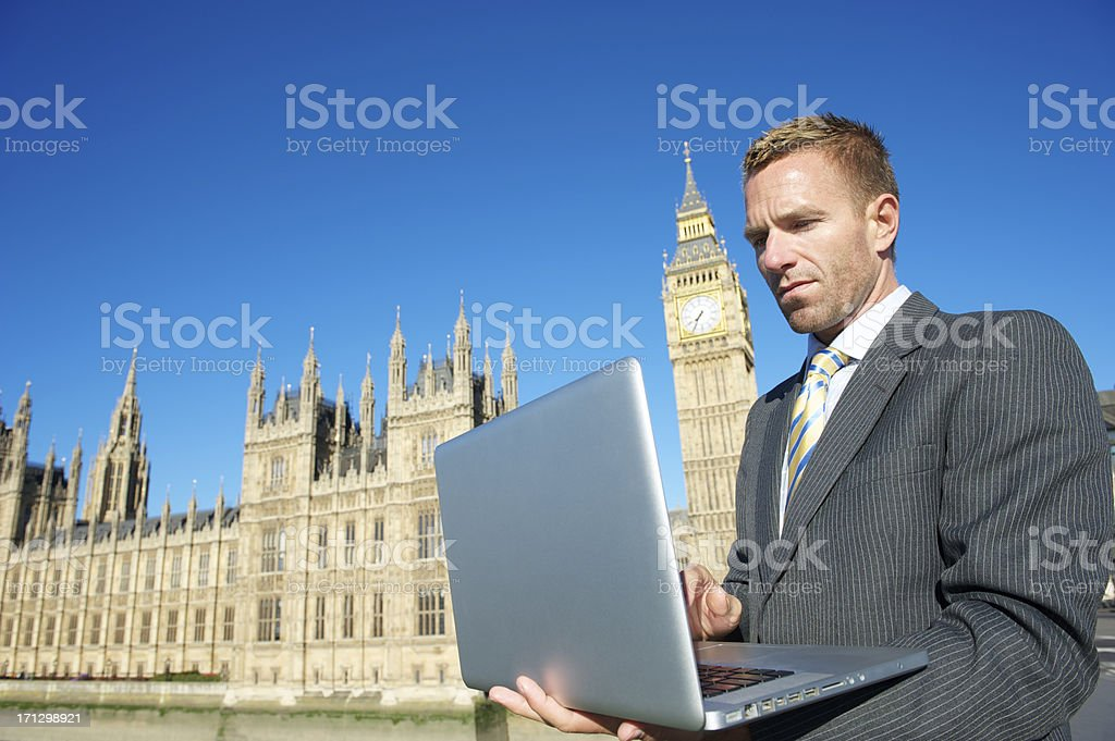 Businessman Uses Laptop Computer in London royalty-free stock photo