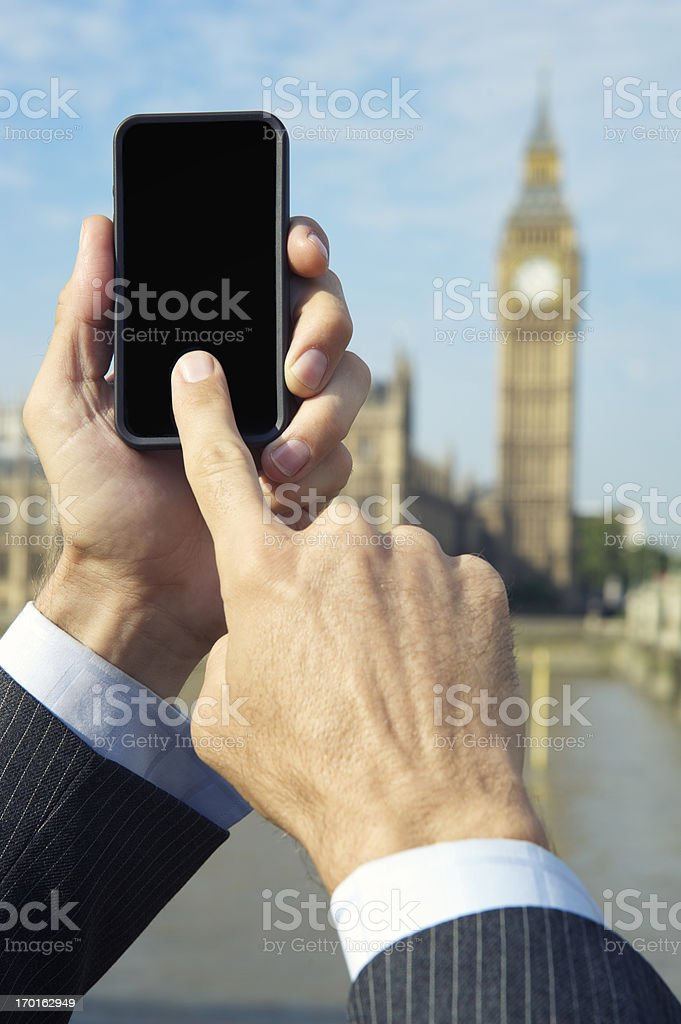 Businessman Uses Smartphone in London royalty-free stock photo