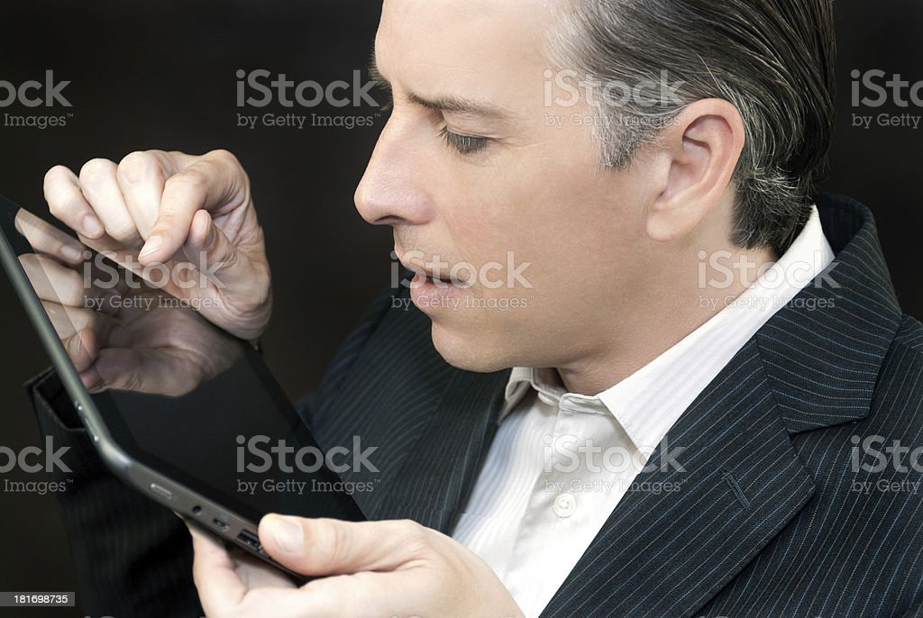 Businessman Uses Tablet, Side Profile royalty-free stock photo