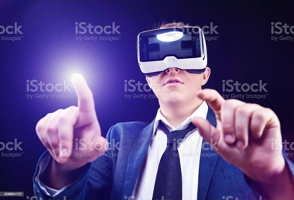 Businessman uses Virtual Reality VR head-mounted display stock photo