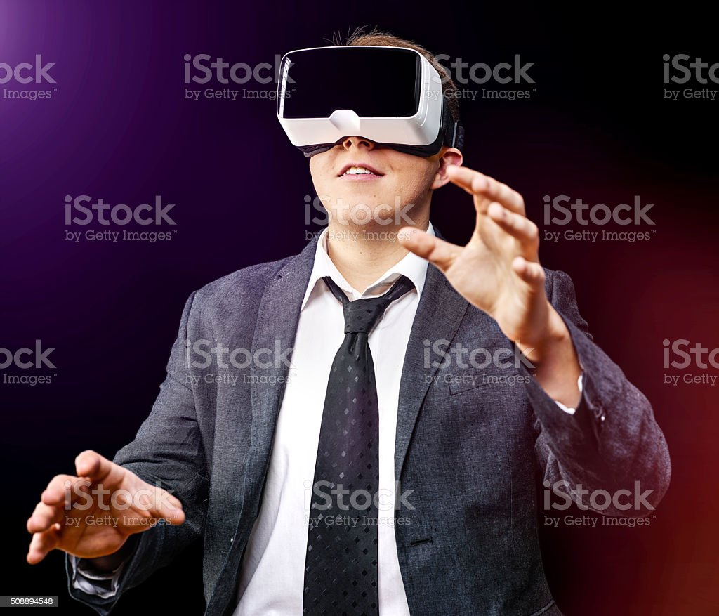 Businessman uses Virtual Reality VR head-mounted display stock photo