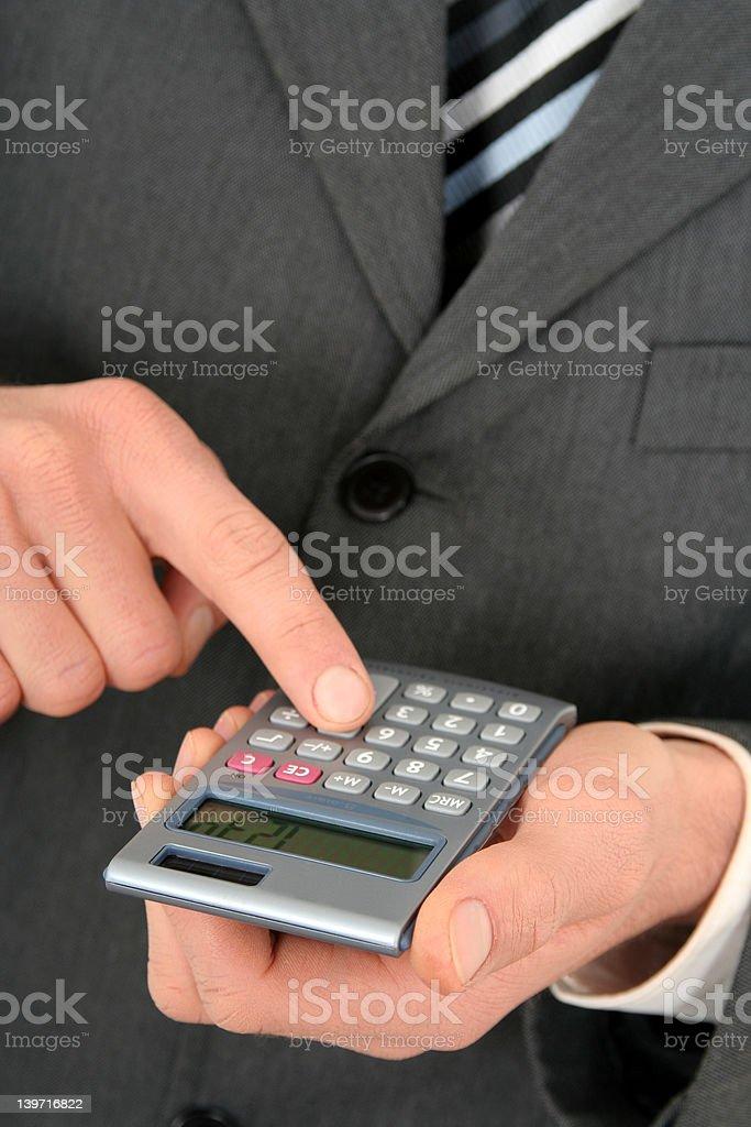 Businessman Using a Calculator royalty-free stock photo