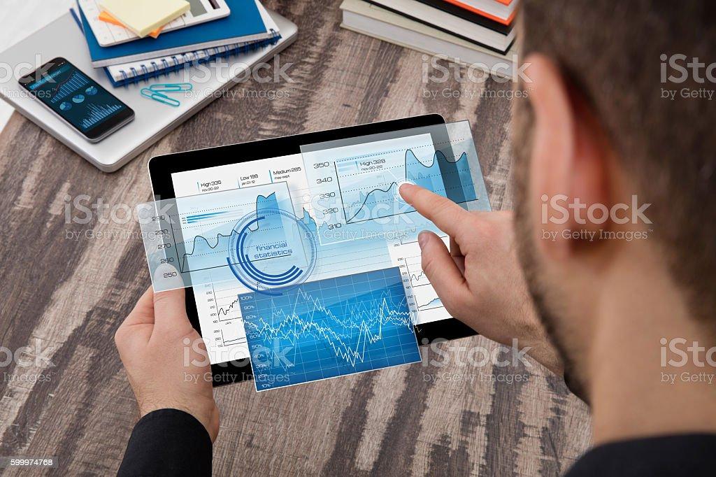 Businessman using a digital display stock photo