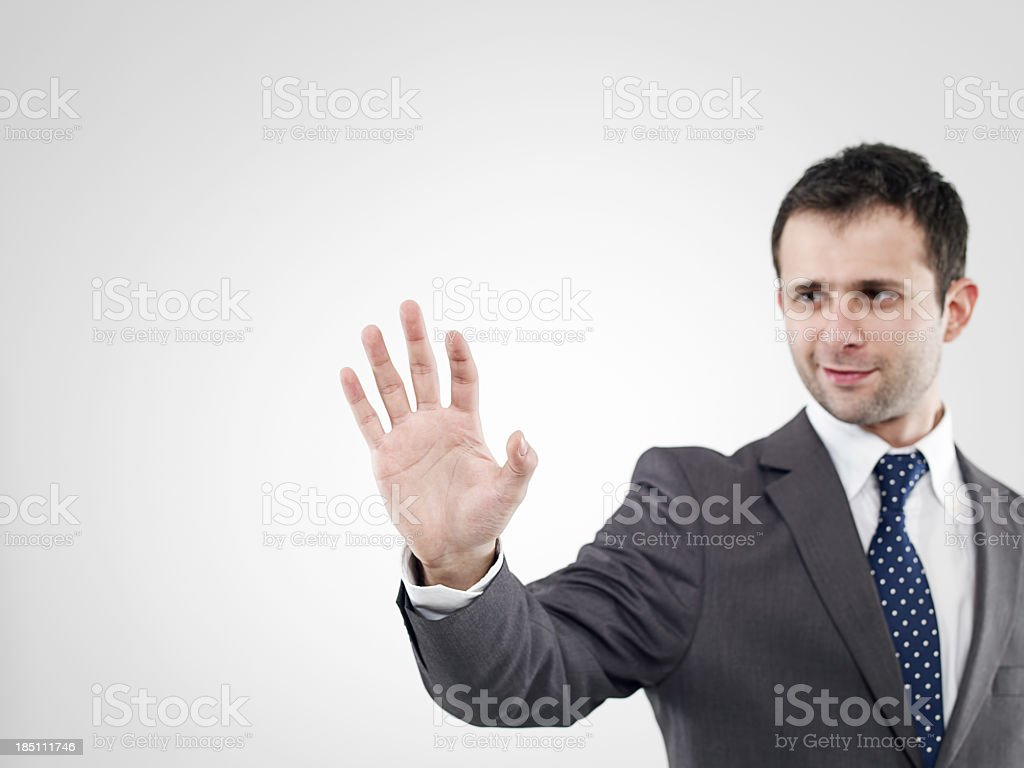 A businessman using a digital interface royalty-free stock photo