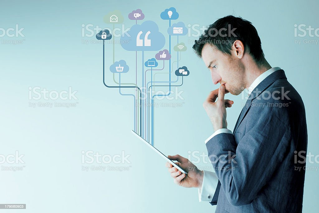 Businessman using a digital tablet royalty-free stock photo