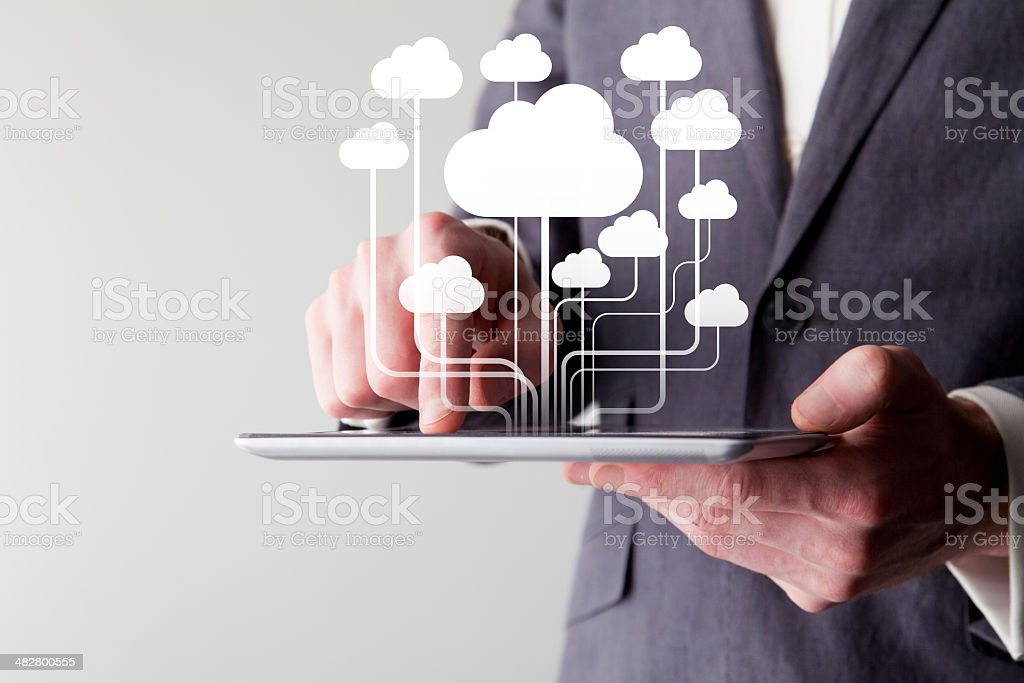 Businessman using a digital tablet stock photo