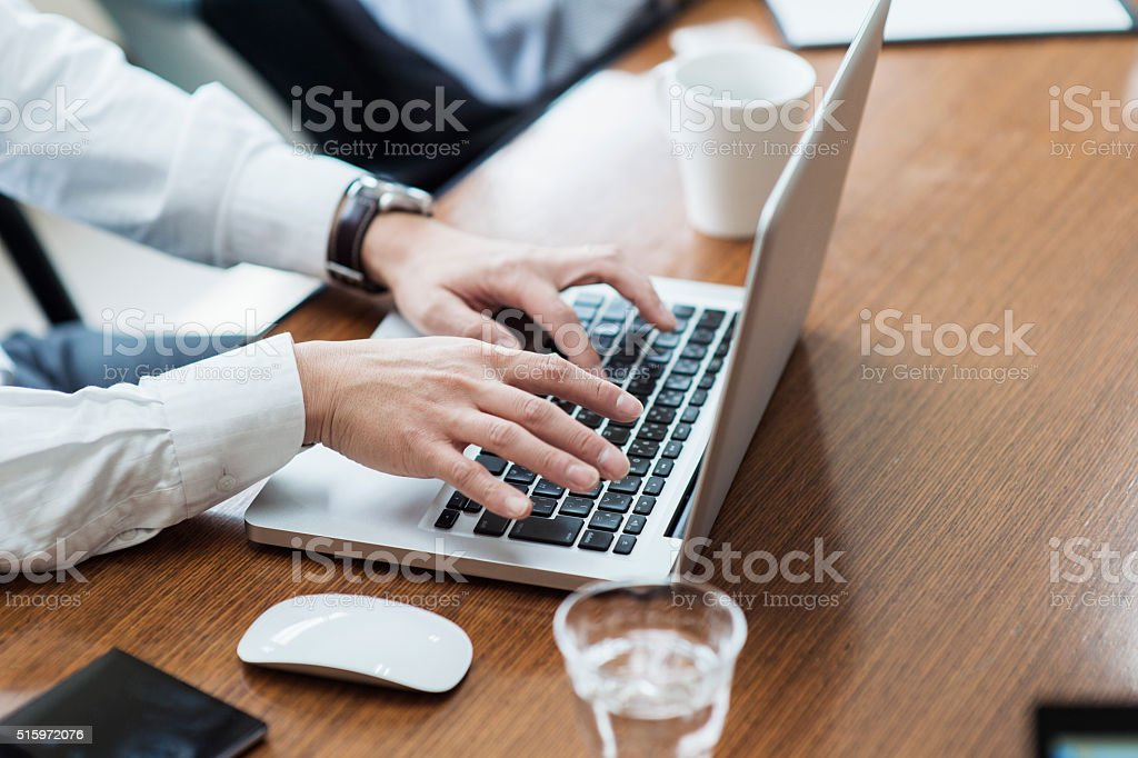 Businessman using a laptop PC stock photo