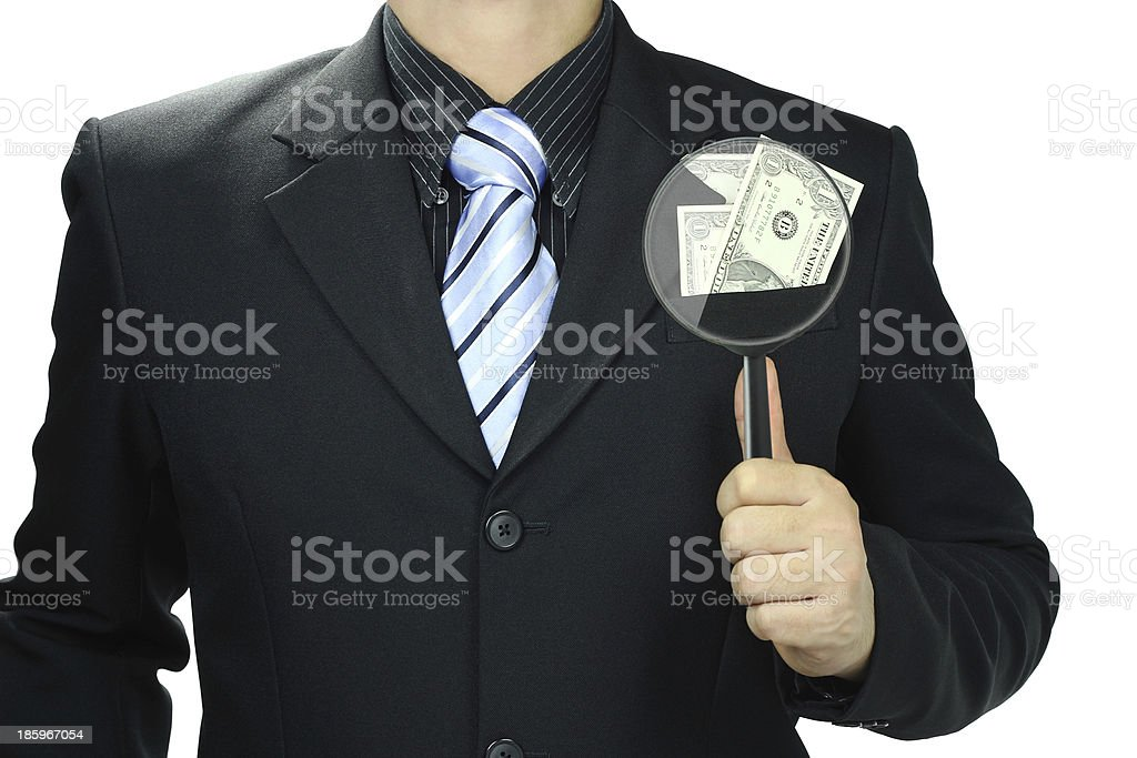 Businessman using a magnifying glass. royalty-free stock photo