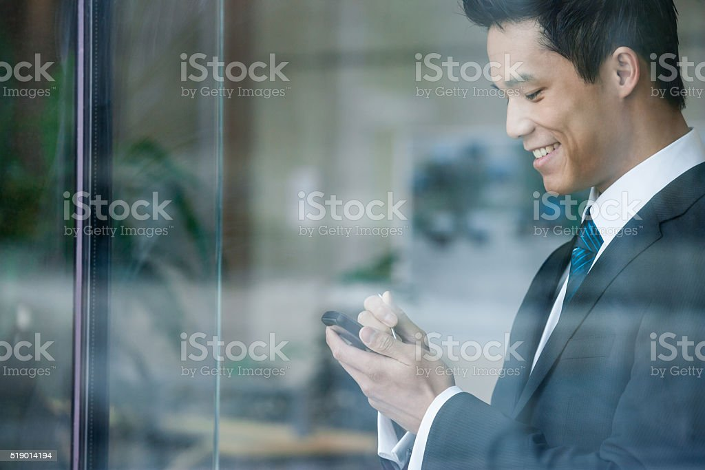 Businessman using a pda stock photo