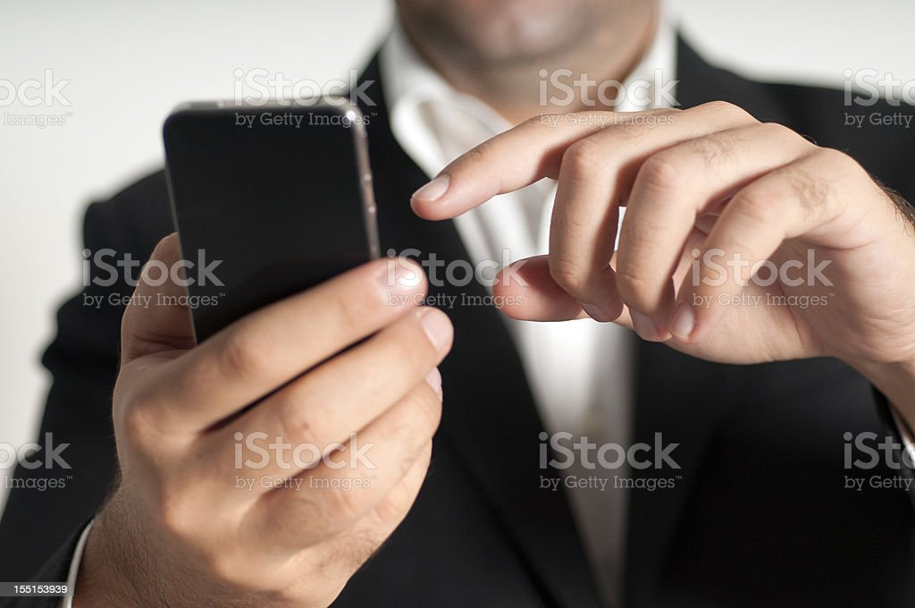 Businessman using a smart phone royalty-free stock photo