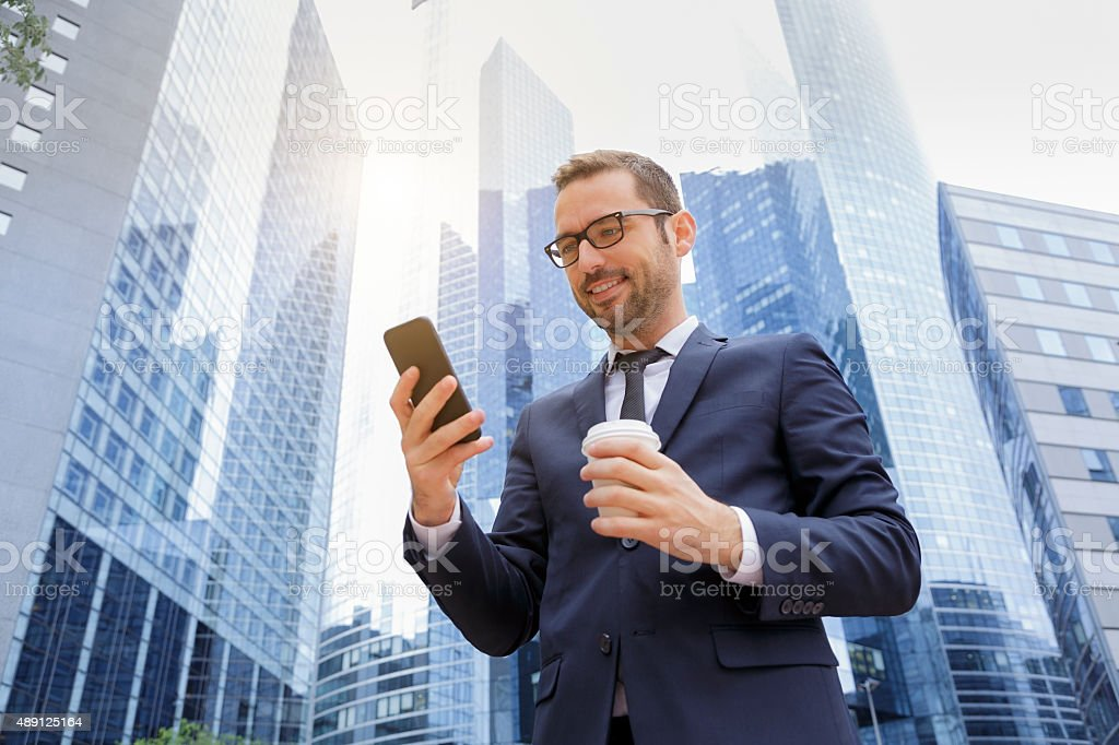 Businessman using a smart phone stock photo