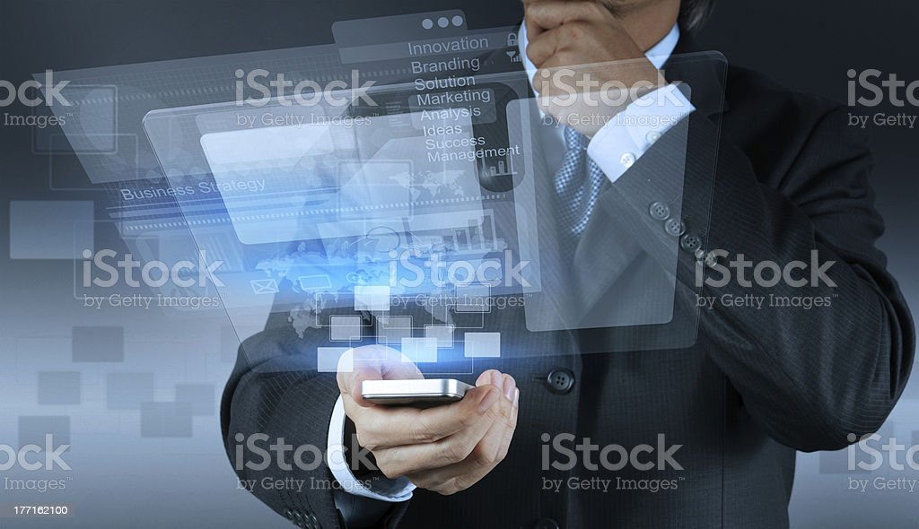 A businessman using a smart phone to display a slideshow stock photo