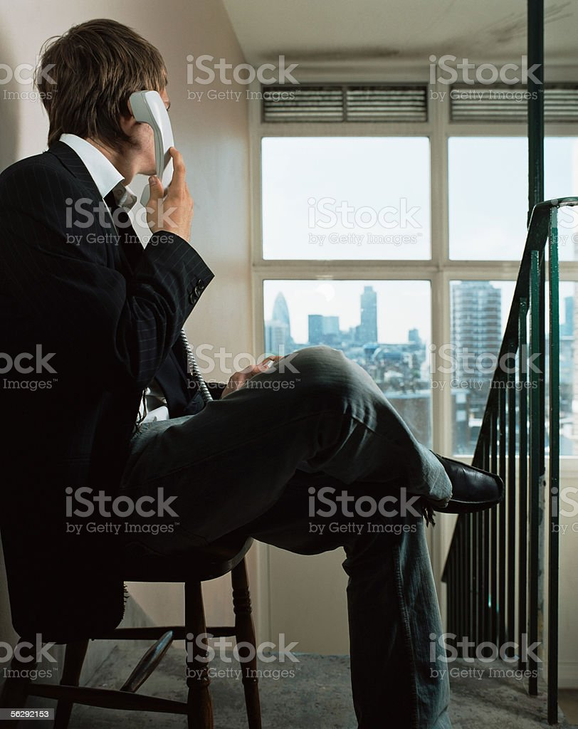 Businessman using a telephone in corridor royalty-free stock photo