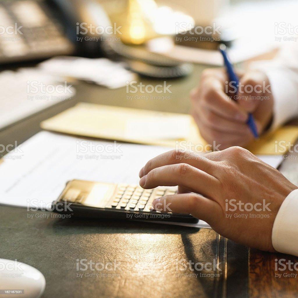 Businessman using calculator stock photo