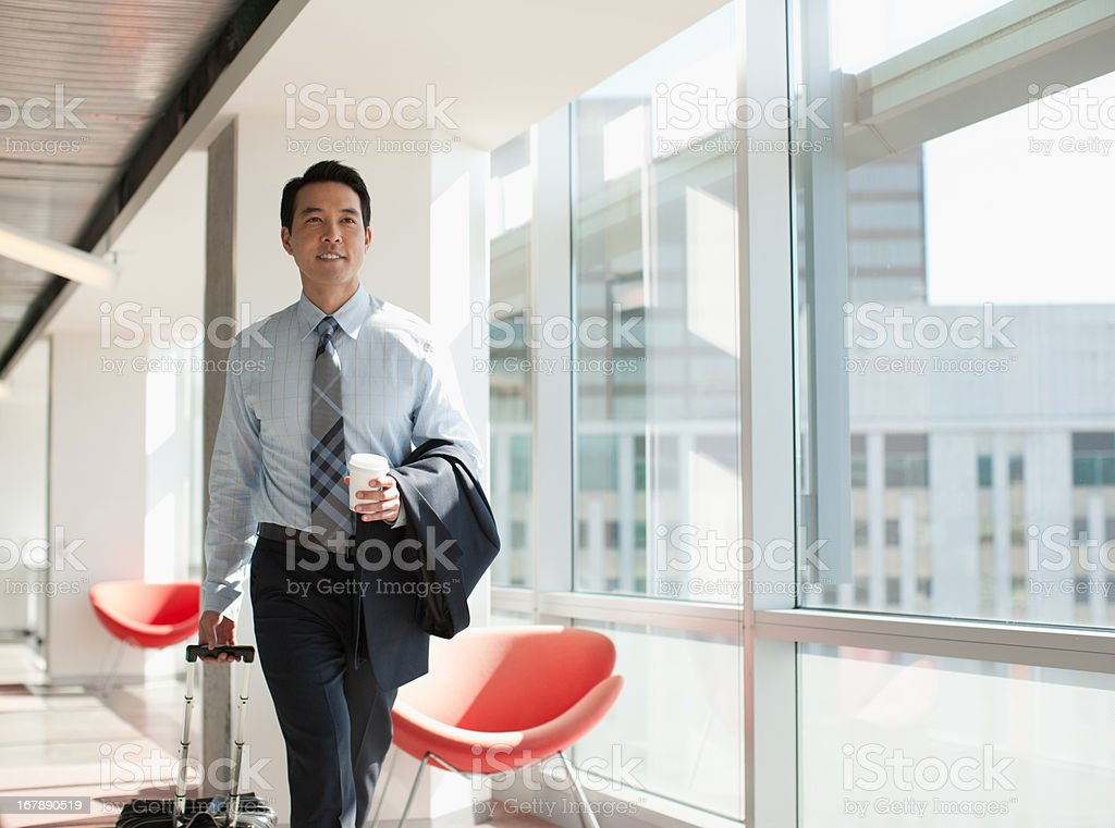 Businessman using cell phone in office royalty-free stock photo