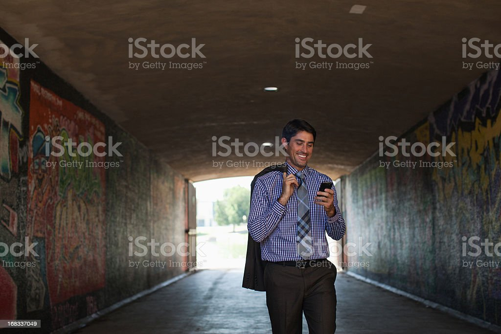 Businessman using cell phone in tunnel royalty-free stock photo