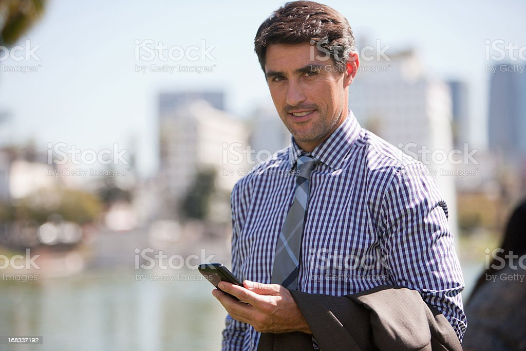 Businessman using cell phone outdoors royalty-free stock photo