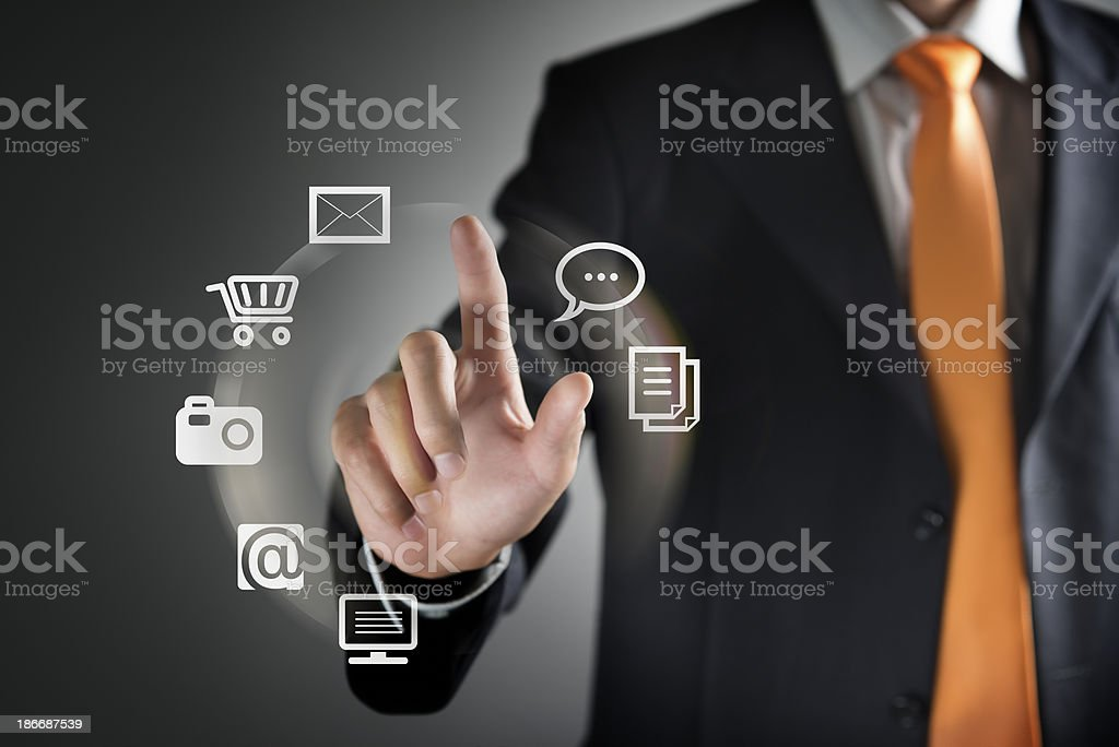Businessman using clear wall as a touchscreen stock photo