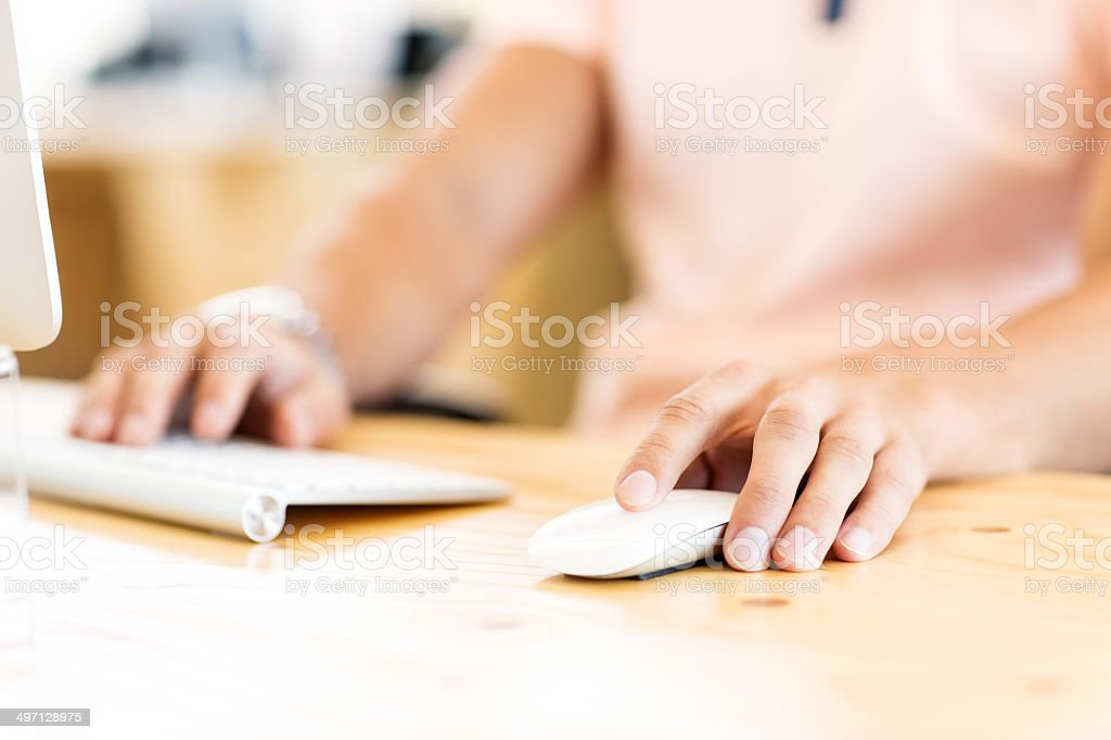 Businessman Using Computer At Desk stock photo