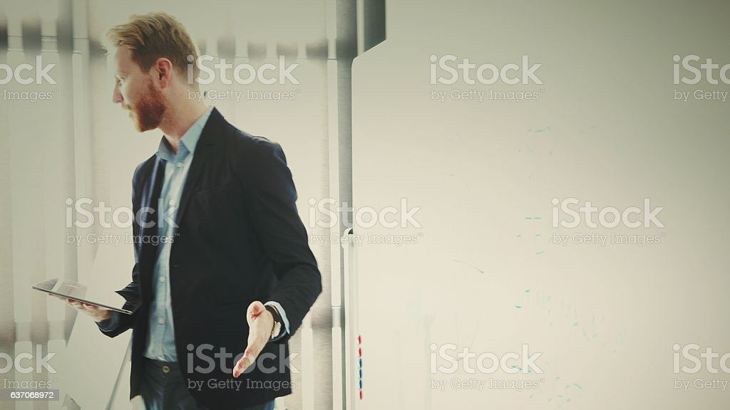 businessman using digital tablet in the office stock photo