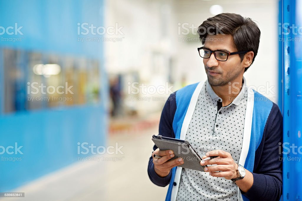 Businessman using digital tablet in warehouse stock photo