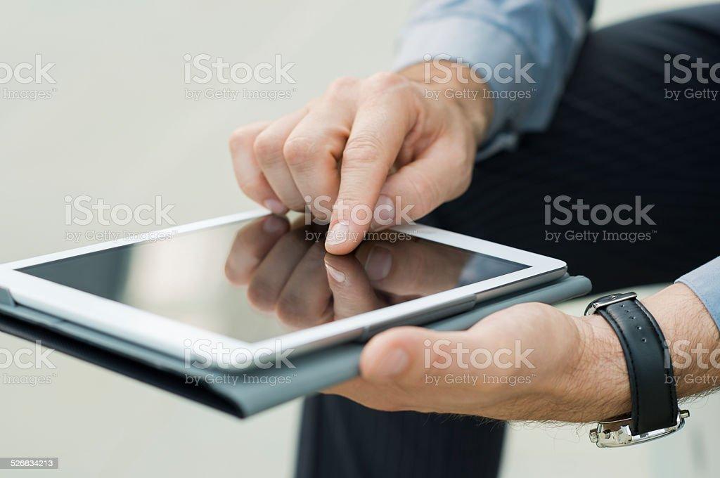 Businessman Using Digital Tablet stock photo