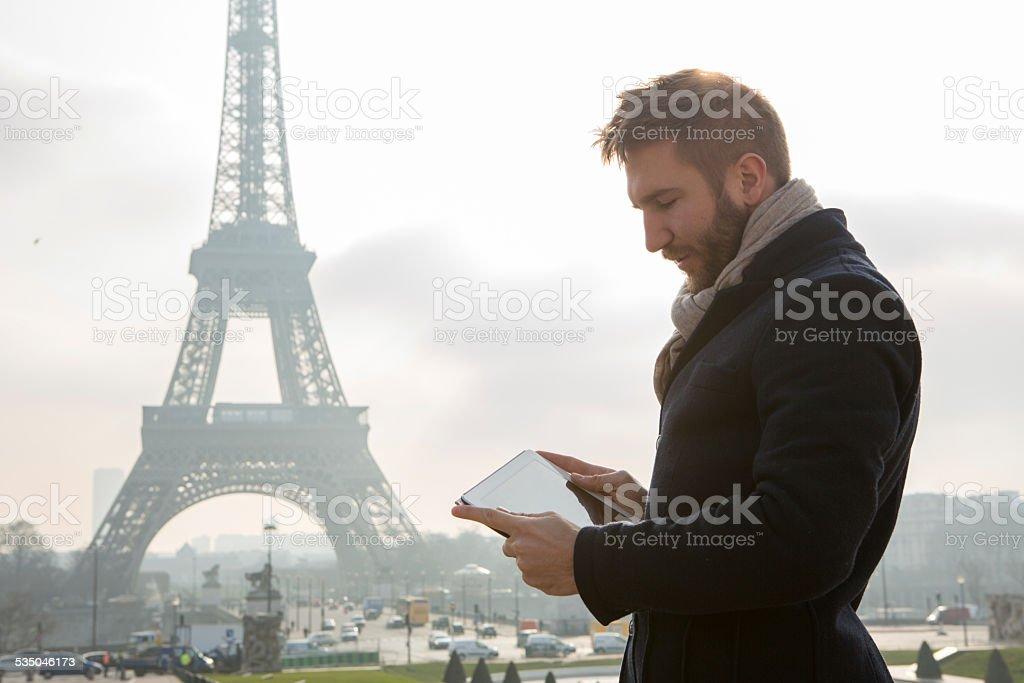 Businessman using digital tablet-Paris-Eiffel tower stock photo