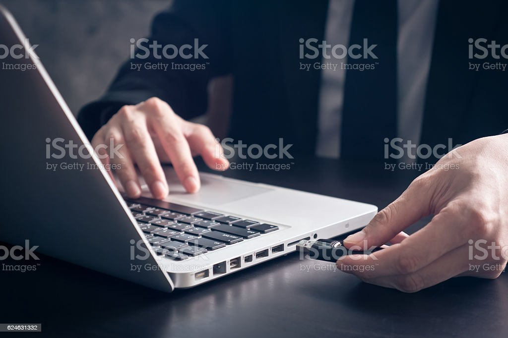 Businessman using flash drive connect to laptop stock photo