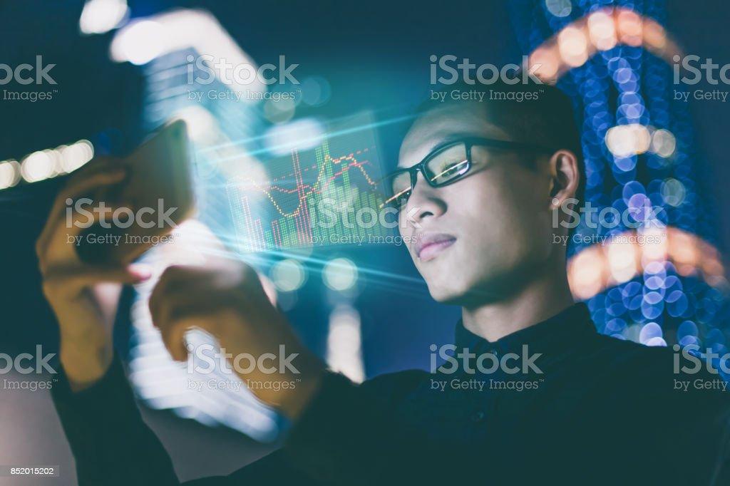 Businessman using futuristic mobile phone stock photo