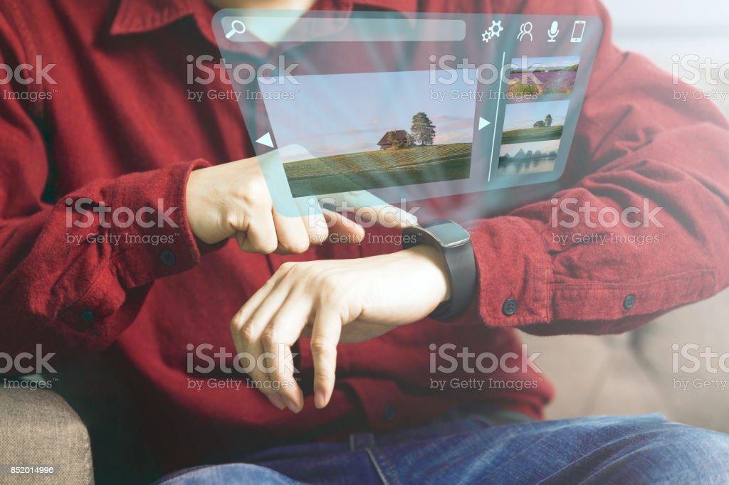 Businessman using futuristic smartwatch stock photo