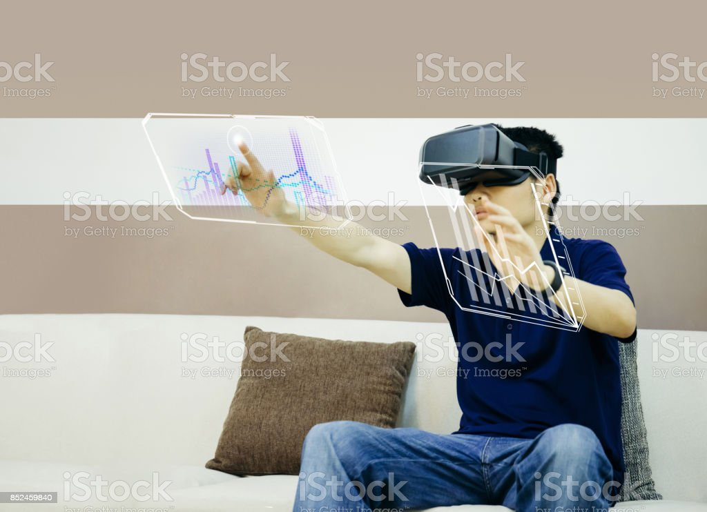 Businessman using futuristic VR stock photo