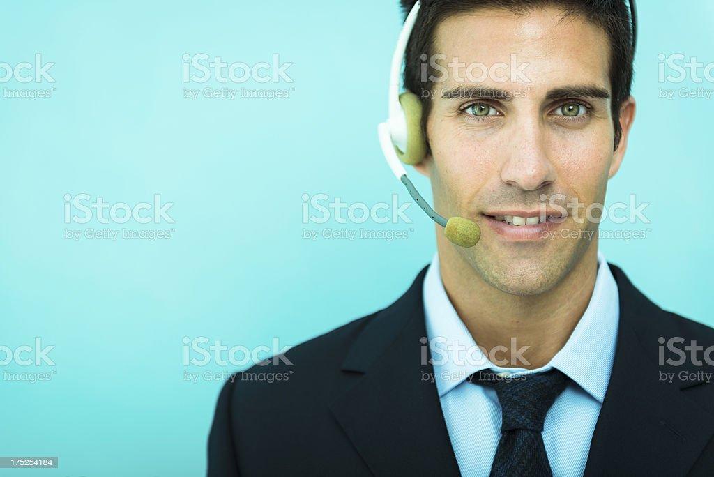 Businessman using headset royalty-free stock photo