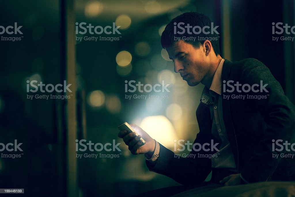 Businessman using his smart phone royalty-free stock photo