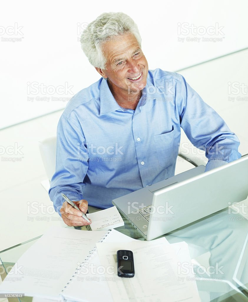 Businessman using laptop in an office royalty-free stock photo