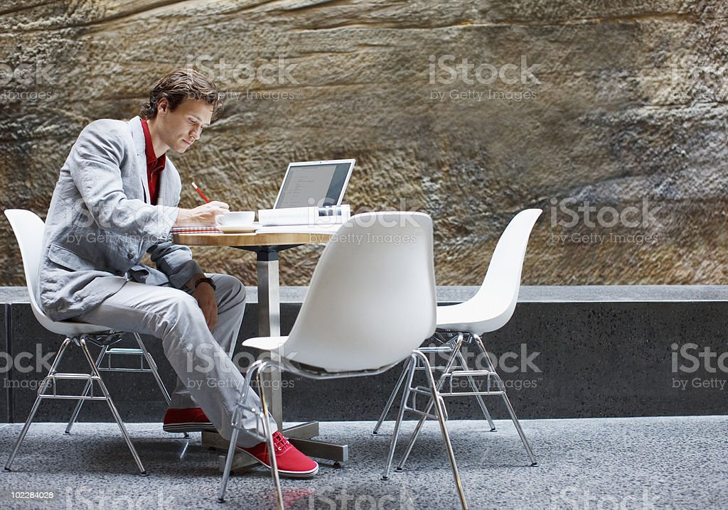 Businessman using laptop in cafe royalty-free stock photo