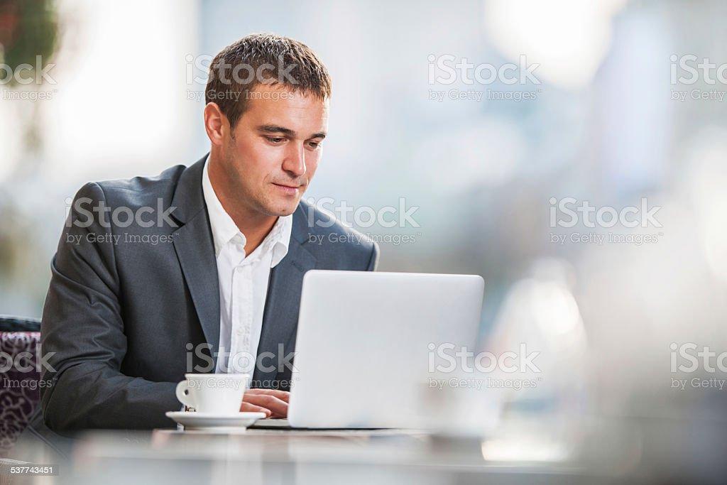 Businessman using laptop on a break. stock photo