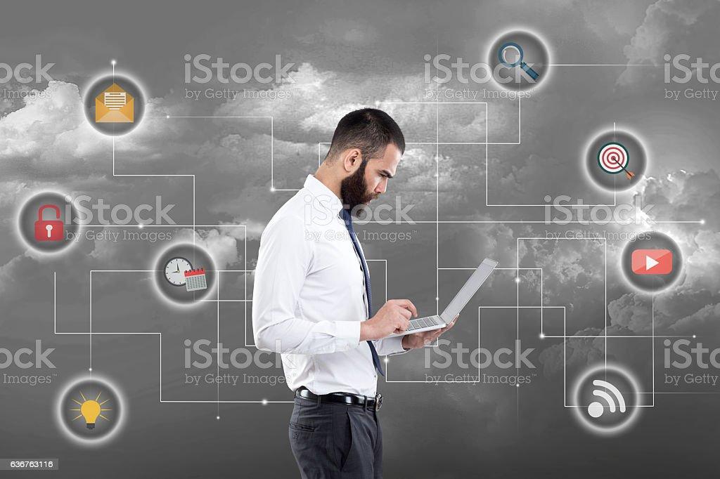 Businessman using laptop stock photo